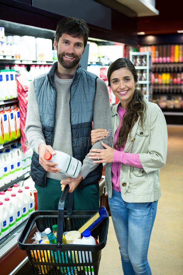 Portrait of couple shopping in grocery section. Portrait of smiling couple shopping in grocery section at supermarket stock photos