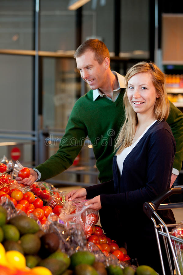 Download Portrait Of Couple In Supermarket Stock Photo - Image of cheerful, grocery: 20526804