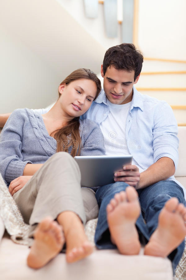 Portrait Of A Couple Using A Tablet Computer Stock Photography