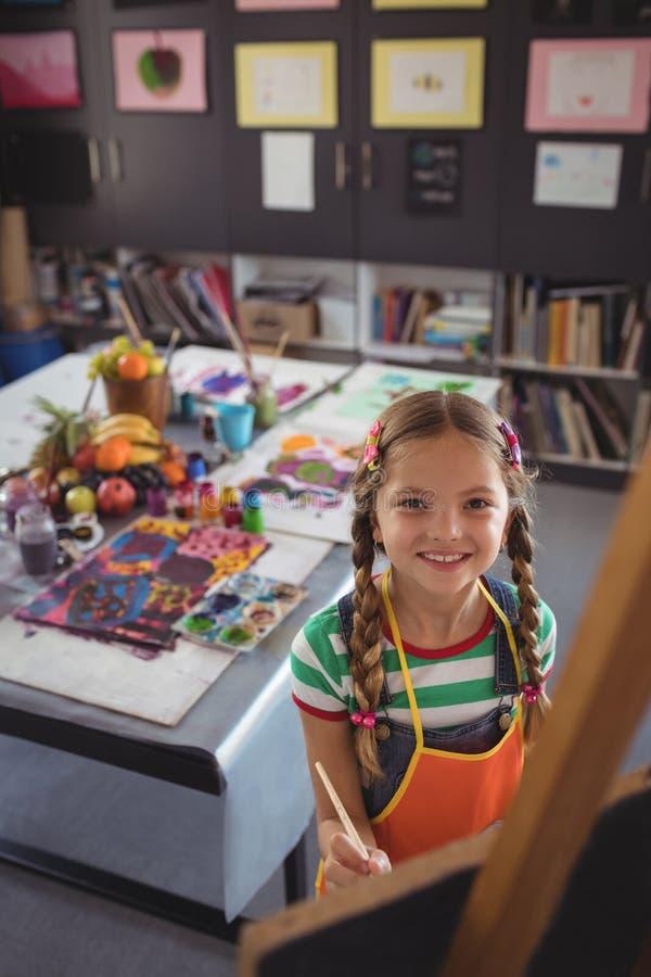 Portrait courbe de la peinture de fille sur la toile photographie stock libre de droits