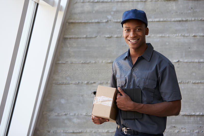 Portrait Of Courier Collecting Package From Office royalty free stock images