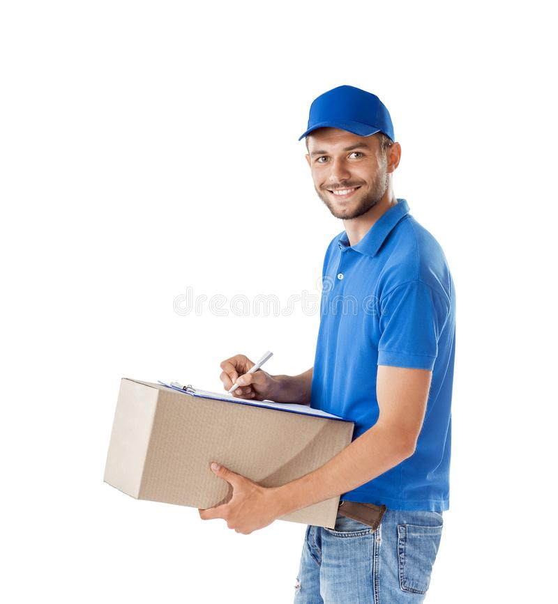 Portrait of courier fills paper on delivery box isolated on whit. E background stock photo