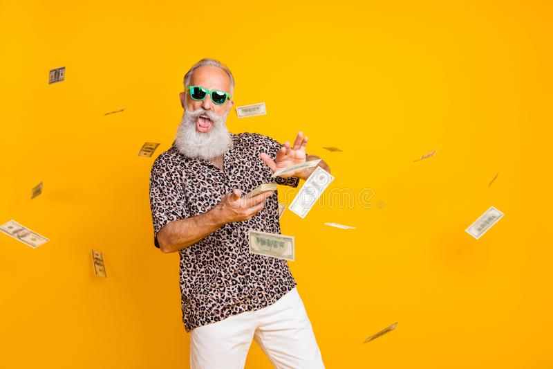 Portrait of crazy funny funky old long bearded man millionaire in eyewear eyeglasses waste money throw banknotes wear royalty free stock photography
