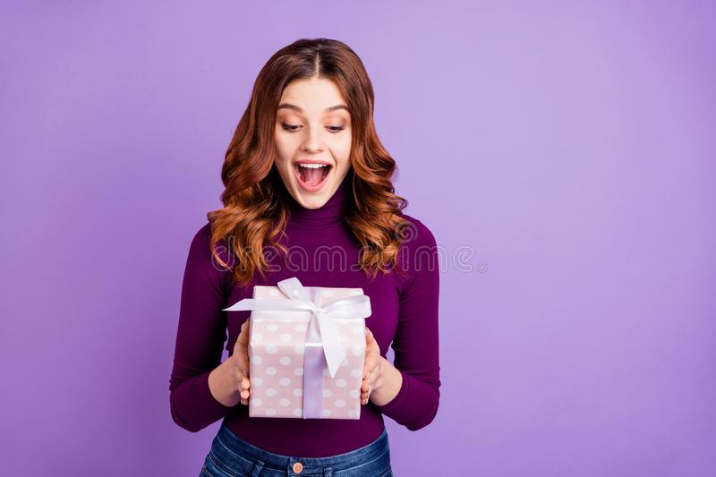Portrait of crazy lovely girl hold hand giftbox look shout isolated over violet purple background. Portrait of crazy lovely girl hold, hand giftbox look shout stock photos