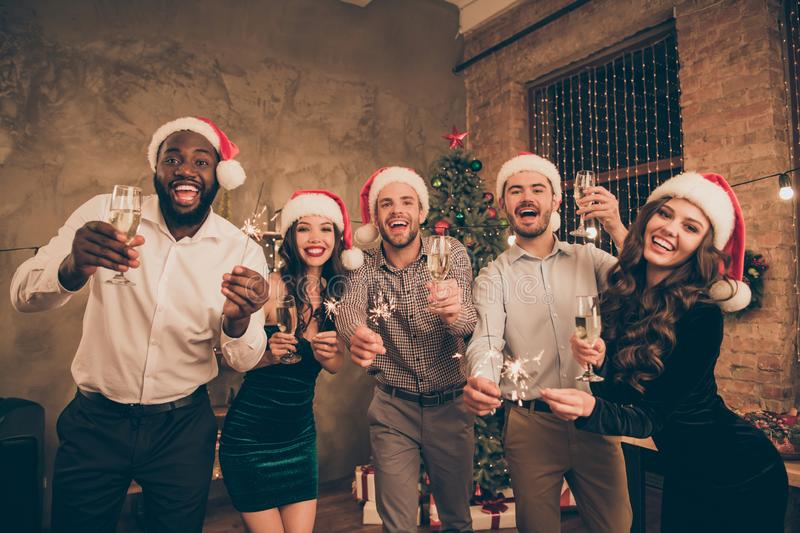 Portrait of crazy lovers having glass with champagne give toast celebrate christmas time at x-mas party in house indoors. Portrait of crazy lovers having glass royalty free stock photos