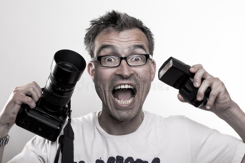 Portrait of a crazy photographer stock image