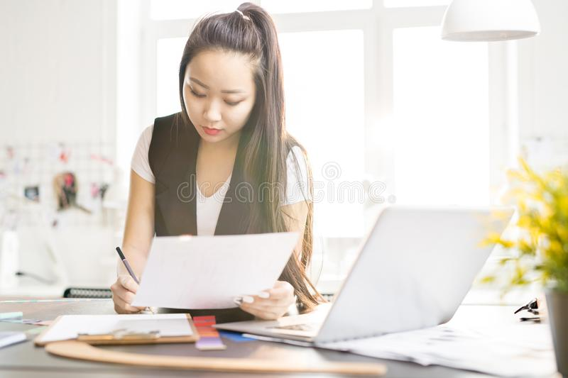 Creative Asian Woman Working in Design Studio royalty free stock photography