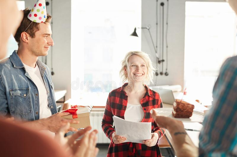 Blonde Woman Celebrating Birthday in Office royalty free stock photography