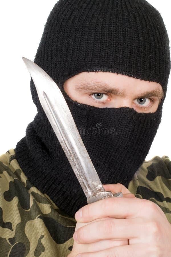 Portrait of the criminal in a black mask
