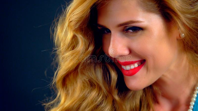 Portrait cropped shot beautiful woman with long wavy hair. stock photo