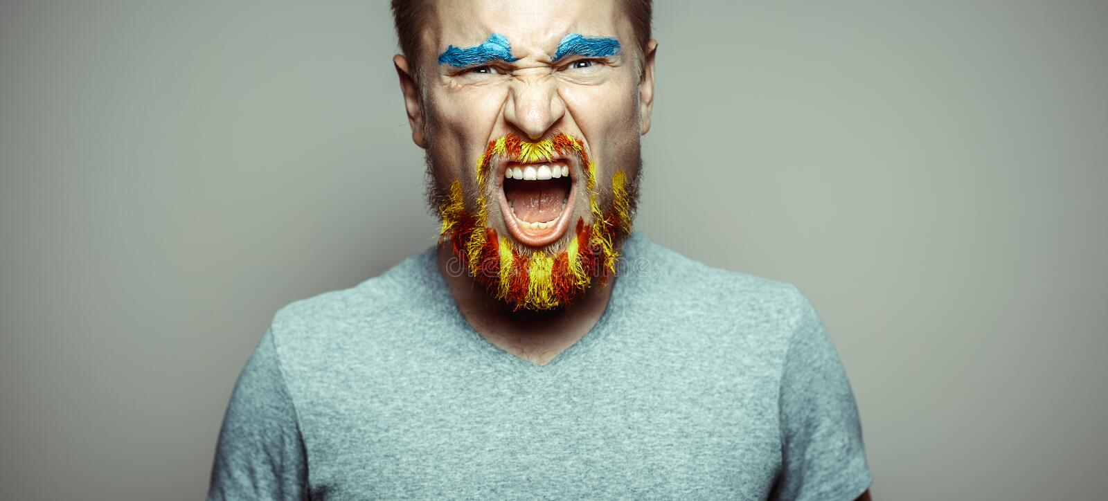 Portrait Of A Cry Man With A beard, Unraveled In Red And Yellow Colors . Referendum For The Separation Of Catalonia From Spain. De royalty free stock image
