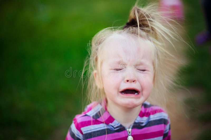 Portrait crying with tears of a child royalty free stock photography