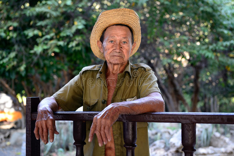 Portrait of the Cuban farmer on deaths of Fidel Castro. LA MULA, SANTIAGO DE CUBA, CUBA - NOVEMBER 26: Portrait of the of the sad Cuban farmer on deaths of Fidel stock images
