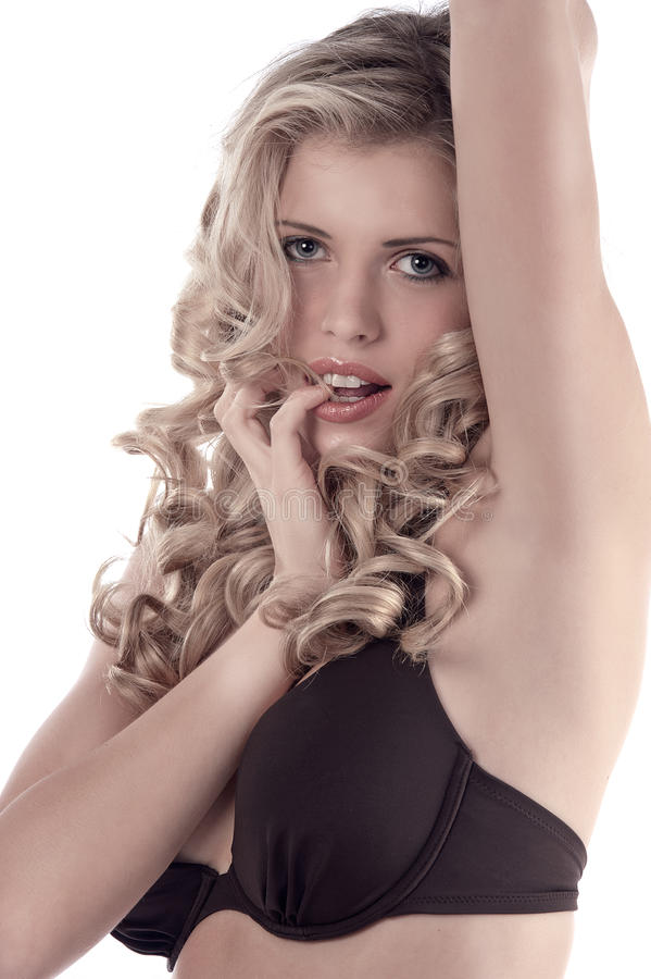 Portrait of a curled blonde in bikini stock images