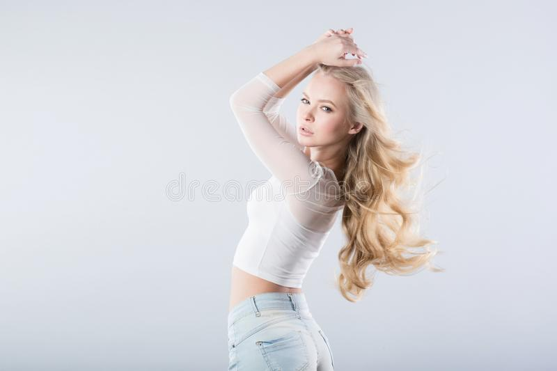 Portrait curly blonde wind hair royalty free stock photos