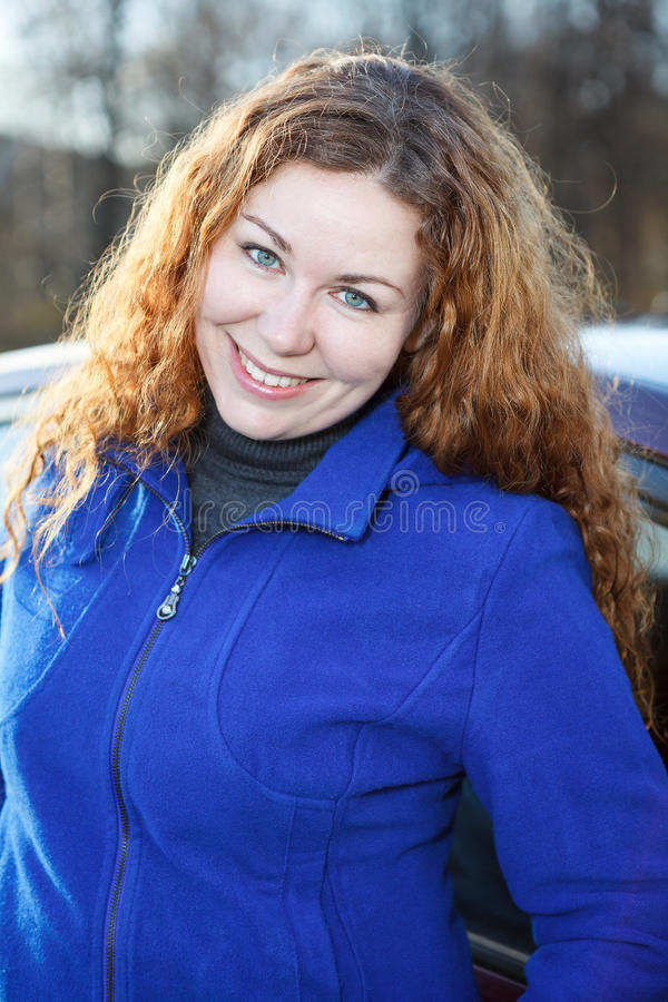 Portrait Of Curly Hair Young Woman Stock Photo