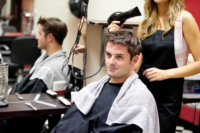Portrait of a customer with a female hairdresser royalty free stock photo