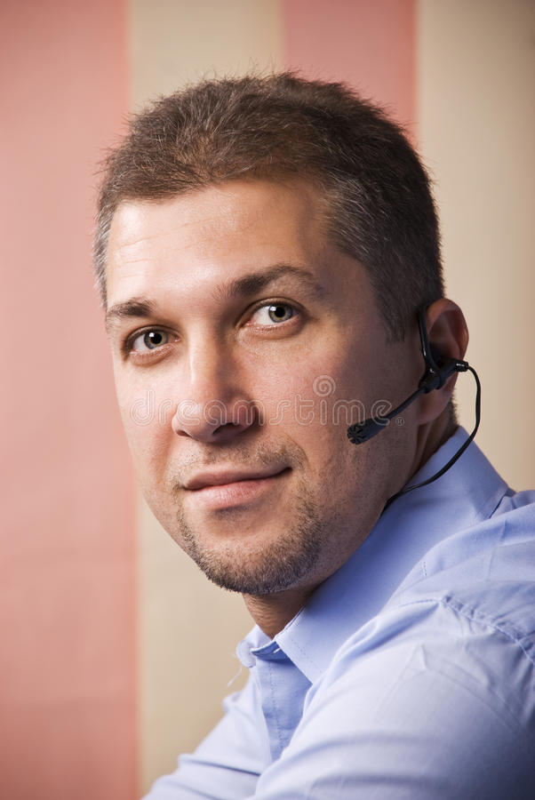 Portrait of customer service beard man. With headset ,smiling and looking you.Check also,for pictures similar or the same series stock images