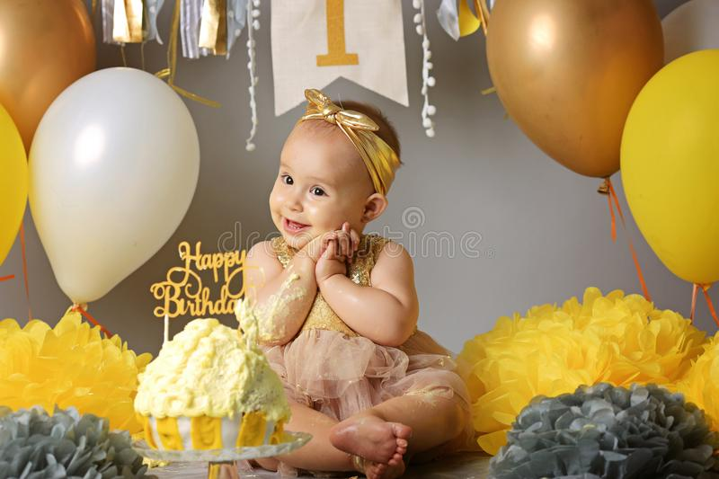 Portrait of cute adorable Caucasian baby girl in tutu tulle skirt celebrating her first birthday. Cake smash concept. Child royalty free stock photo