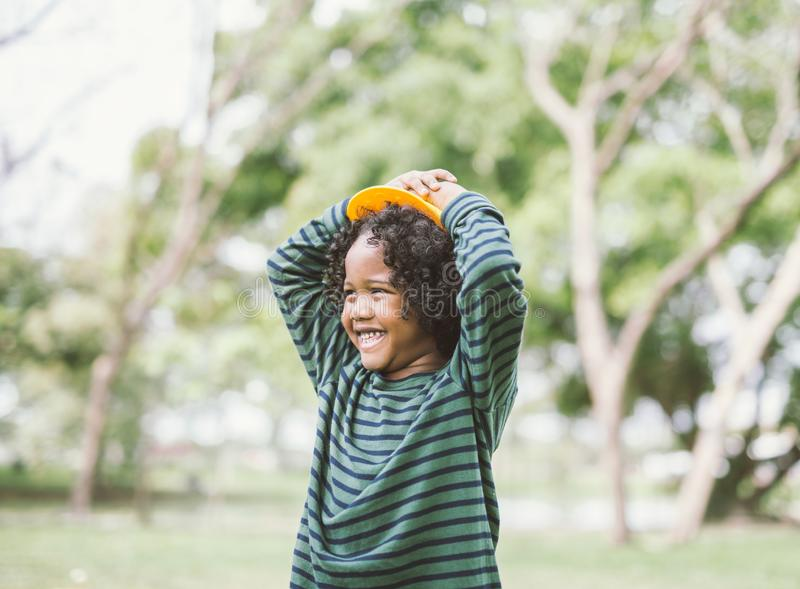 Portrait of a cute african american little boy smiling. stock image