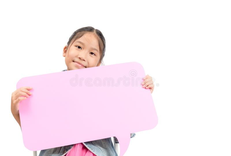 Portrait of cute asian girl holding empty pink speech bubble royalty free stock image