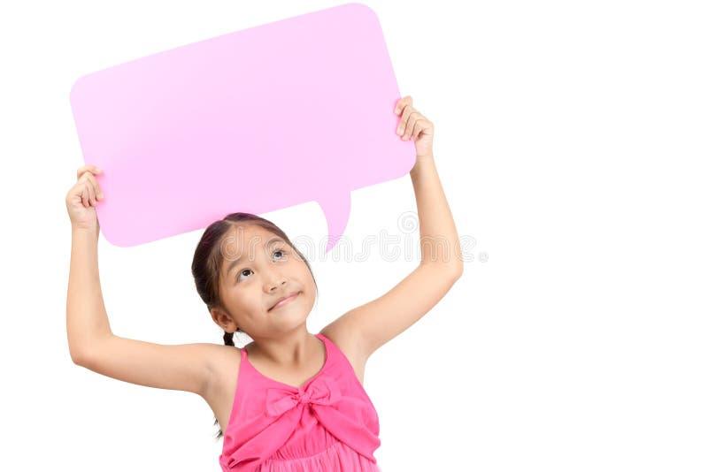 Portrait of cute asian girl holding empty pink speech bubble stock image