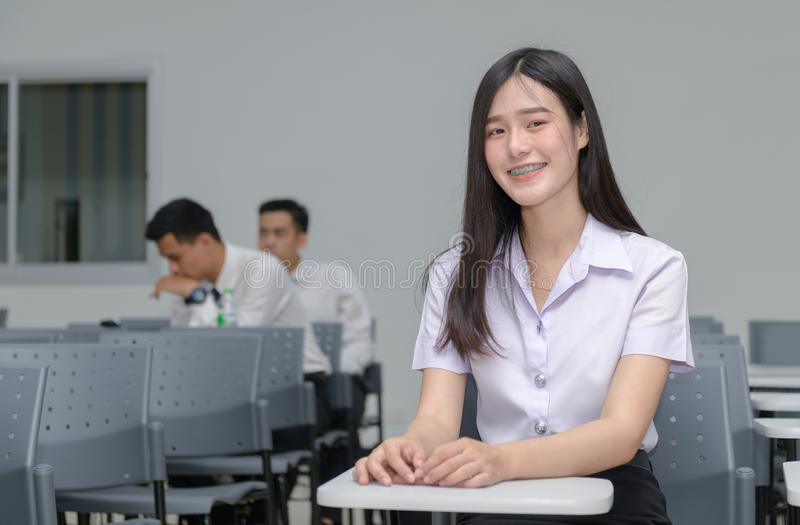 Portrait of cute asian girl student with braces on the teeth stock image