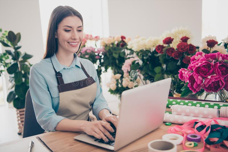 Portrait of cute attractive youth millennial use user device dialogue client positive cheerful satisfied workplace chat royalty free stock photos