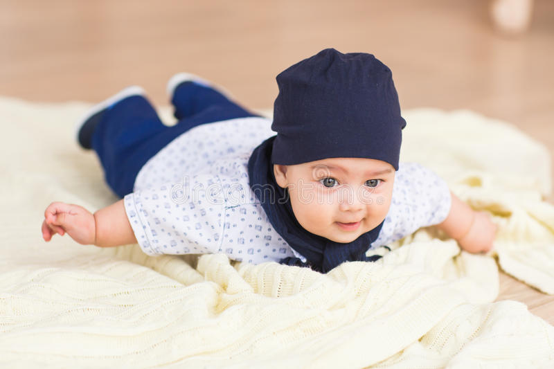 Portrait of a cute baby boy smiling. Adorable four month old child. royalty free stock photography