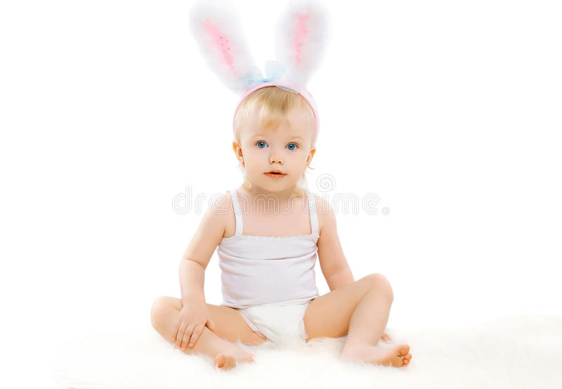 Portrait of cute baby in costume easter bunny with fluffy ears. On a white background stock photography