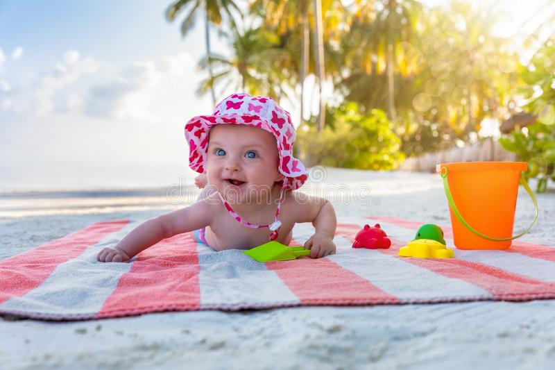 Portrait of a cute baby girl on a tropical beach stock photography