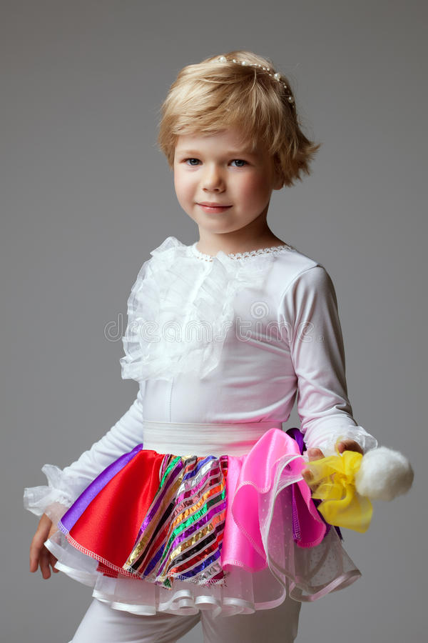 Portrait of cute blond ballerina posing at camera royalty free stock image