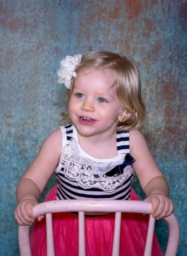 Portrait of a cute blond toddler royalty free stock image
