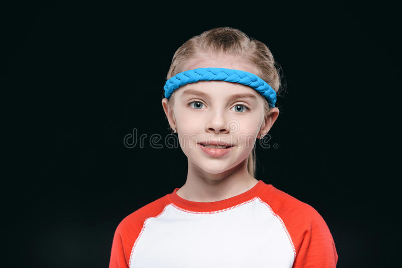Portrait of cute blonde girl in sportswear looking at camera royalty free stock photos