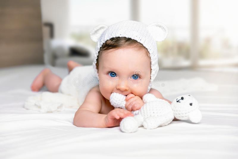Portrait of a cute, blue eyed baby girl stock photos