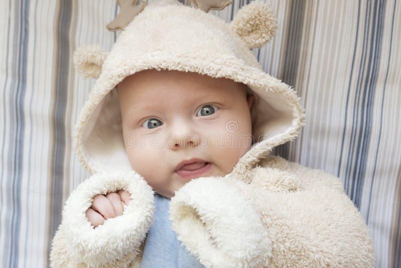 Portrait of a cute kid in a deer suit. Portrait of a cute blue-eyed kid in a deer suit stock photos