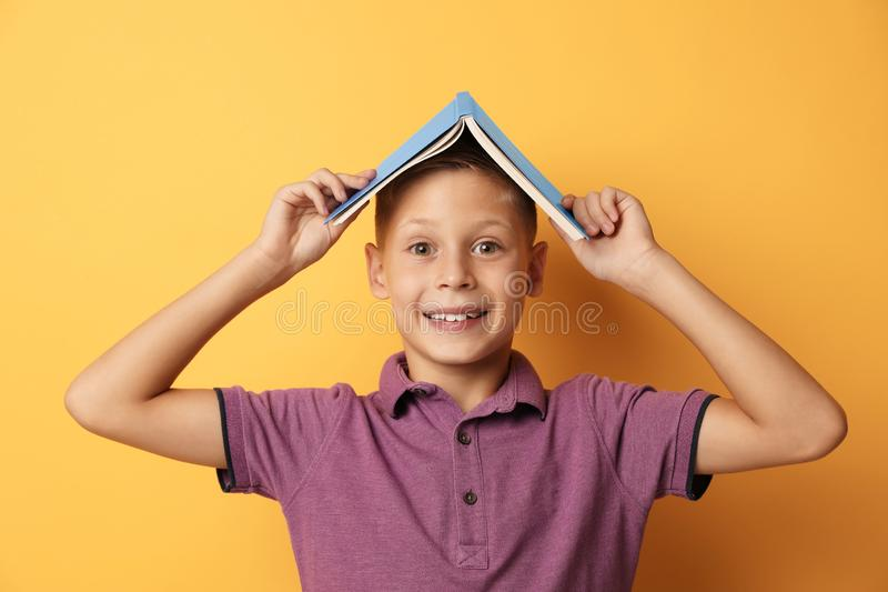 Portrait of cute boy with book on background. Reading concept stock photography