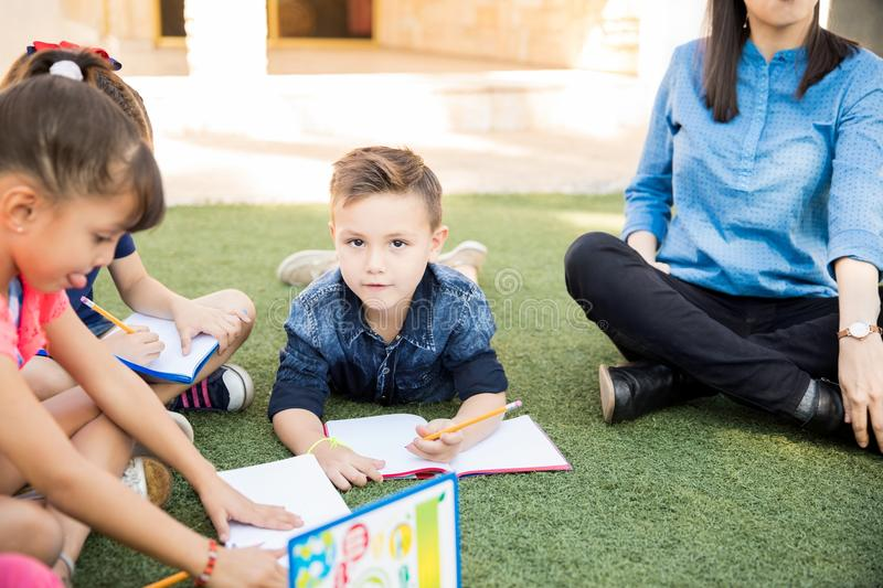 Little boy taking a class outdoors royalty free stock photos
