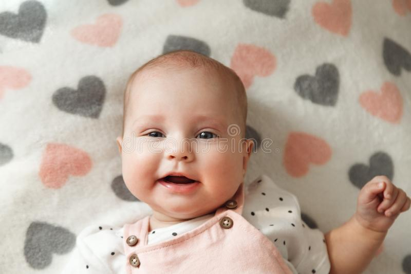 Portrait of cute cheerful baby girl in her room royalty free stock image