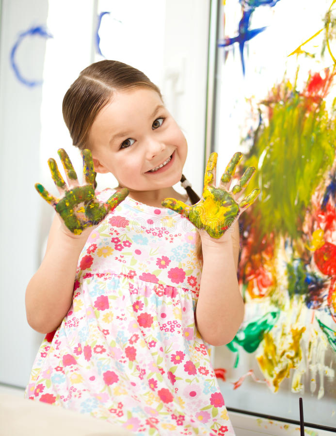 Portrait of a cute girl playing with paints royalty free stock photos