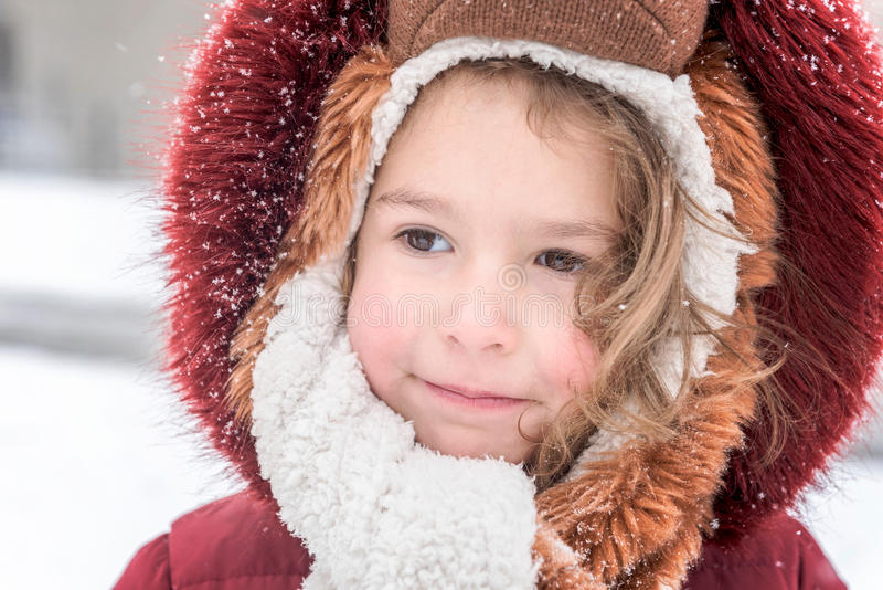 Portrait of cute child. Portrait of little girl outdoor during snow storm stock photos