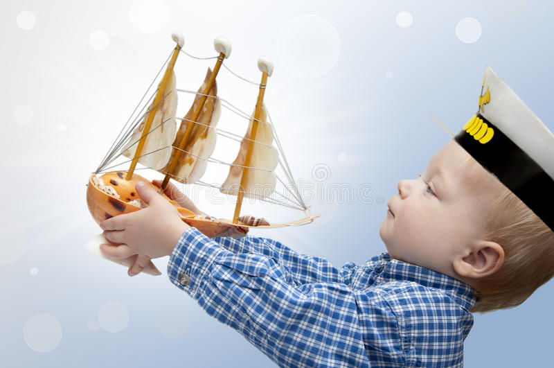 Small captain with the ship stock photography