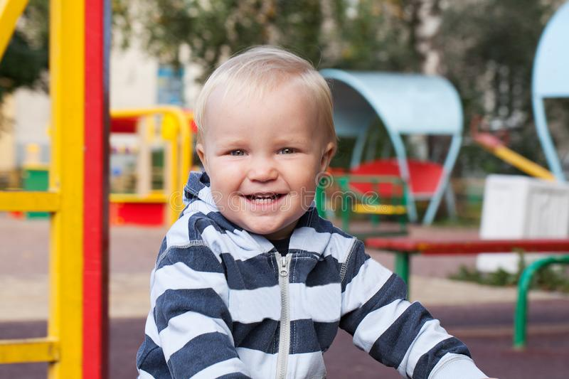 Portrait of cute child playing on playground outdoors royalty free stock photo
