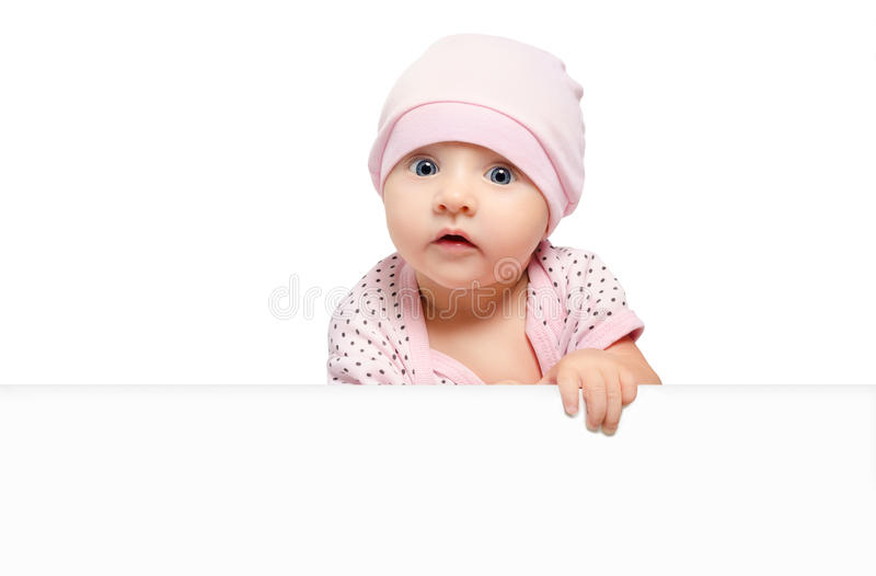 Portrait of cute curious baby girl, peeking from behind a banner stock images