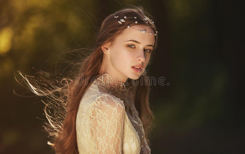 Portrait of a cute dreamy girl wearing retro blouse and skirt outdoors. Soft vintage toning. stock images