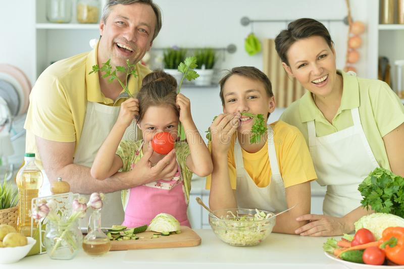 Portrait of cute family cooking together in kitchen stock photo