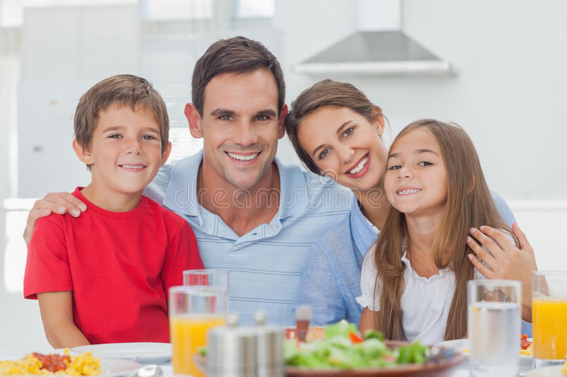 Portrait of a cute family. At the table stock image