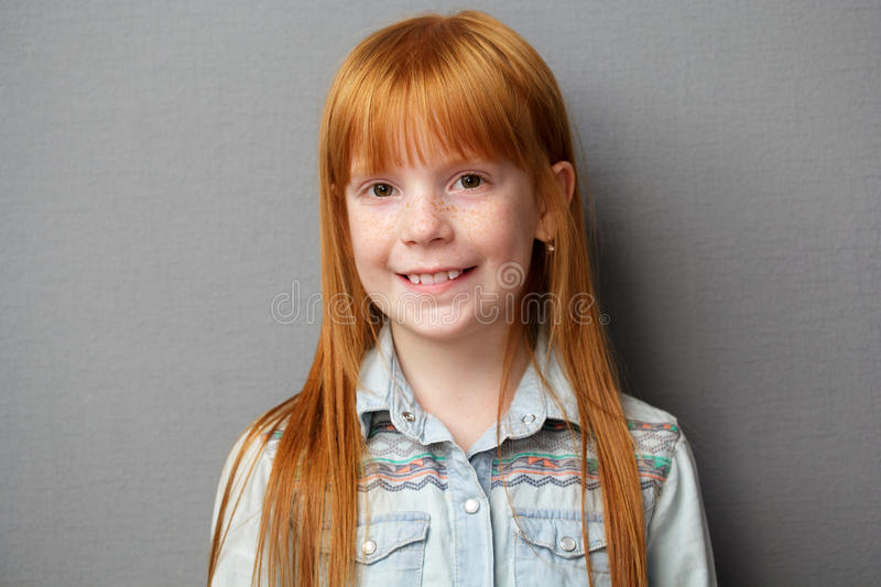 portrait of a cute ginger girl stock photo - image of shirt, gray