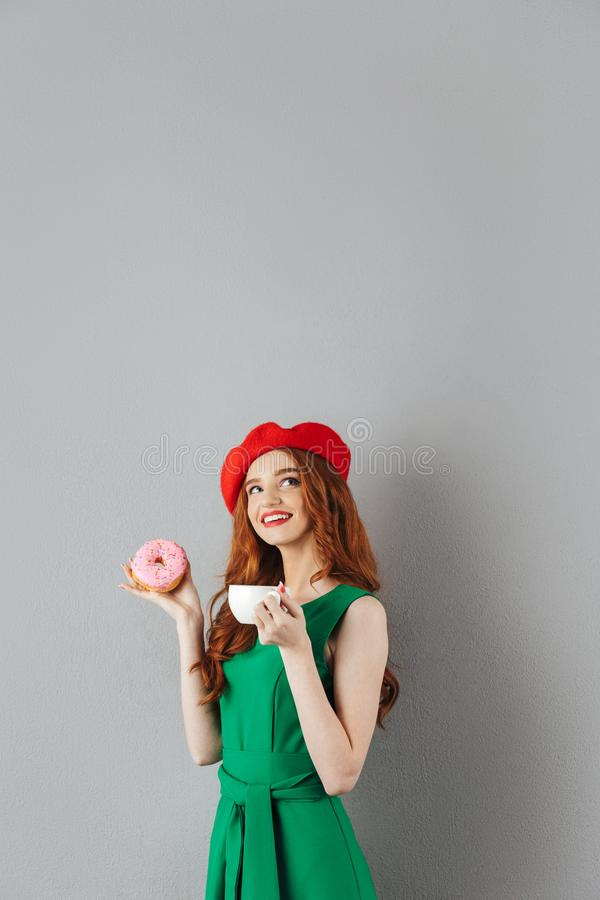 Portrait of cute ginger woman wearing red beret in french style royalty free stock photos