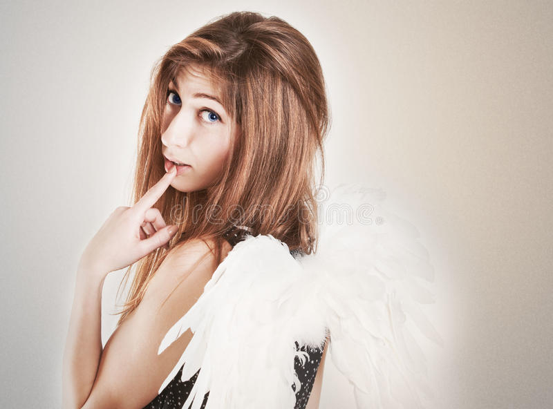 Portrait of cute girl as angel stock images